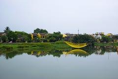 Fishing net on Hoai river, Hoi An, Quang Nam, Vietnam Stock Photo