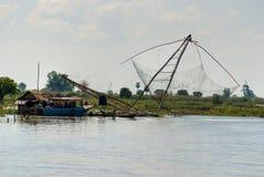 Fishing net and houseboat. Tonle Sap Lake,   Cambo Stock Photo