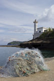 Fishing net and lighthouse Royalty Free Stock Images