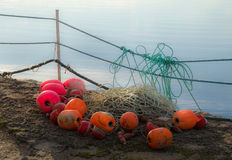 Fishing net lines and markers. On a jetty royalty free stock image