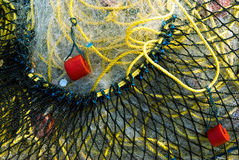 Fishing net macro. Close-up shot of fishing net with red floats Royalty Free Stock Images