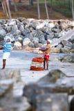 Fishing net with many fishermen on backside. Odayam beach, Varkala, India. Varkala, India - February 09, 2016: Fishing net with many fishermen on backside the stock images
