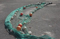 Fishing Net. One Fishing net is drying in the sun royalty free stock image