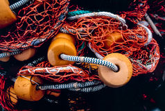 Fishing net with orange floats lays on ground in tangle Royalty Free Stock Images