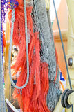 Fishing net with orange ropes on fishing boat Royalty Free Stock Photos