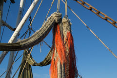 Fishing net with orange ropes on fishing boat Stock Photo