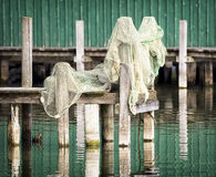 Fishing net on pier Stock Images