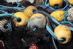 Fishing Net Pile with Yellow Floats Stock Images