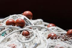 Fishing net with red floats background Royalty Free Stock Image