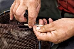 Fishing Net Repair Stock Photography