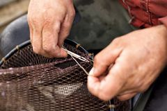 Fishing Net Repair Royalty Free Stock Photos