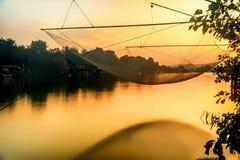 Fishing net on the river Bojana in Montenegro in the sunset Stock Photo