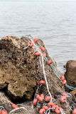 Fishing net on a rock Stock Photo