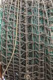 Fishing net rolled up on drum royalty free stock images