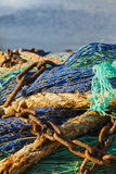 Fishing net with rusty chains with blue sea Stock Image