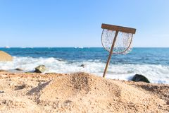 Fishing net at the beach. Fishing net in sand at the beach stock photo