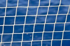 Fishing net. Sea background. Deep blue stock images