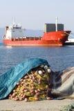 Fishing net and ship. Fishing net and cargo ship Stock Photos