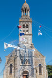 Fishing net spread outside a church. Saint Gilles Croix de Vie, France - August 07, 2016 : fishnet welcoming tense front of a church on the occasion of the fish stock photos