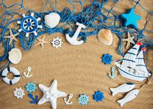 Fishing net with starfish. On a natural sand background stock photo