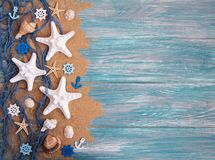 Fishing net with starfish. On a wooden background royalty free stock photos