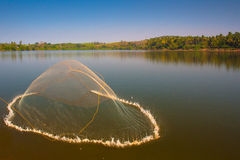 Fishing net thrown. An unusual composition of a usual throwing-fishing net photo Royalty Free Stock Photo