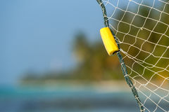 Fishing net on  tropical beach background Stock Photography
