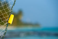 Fishing net on a tropical beach background.  royalty free stock photos