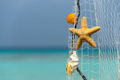 Fishing net on a tropical beach background Royalty Free Stock Photos