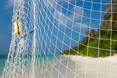 Fishing net on a tropical beach background Stock Image