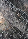 Fishing net. Used fishing fish net made of white rope hanging to dry in a shrimp farm in Thailand royalty free stock photography