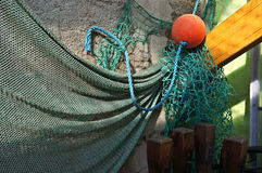 Fishing net on a wall. Fishing net hanging on a wall royalty free stock photo