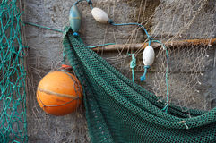 Fishing net on a wall. Stock Image