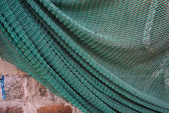 Fishing net on a wall. Stock Photography