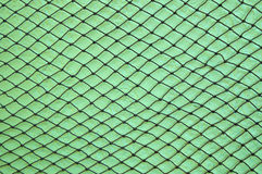 Fishing net on wall Royalty Free Stock Photos