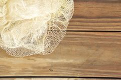 Fishing Net. Closeup of a white fishing net against a wooden background Stock Image