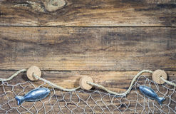 Free Fishing Net With Fish Decoration On Brown Wood Background Royalty Free Stock Photos - 96154788