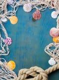 Fishing net on wooden background Stock Image