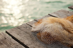Fishing net on a wooden background, sea Royalty Free Stock Photo