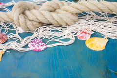 Fishing net on wooden background Royalty Free Stock Photo