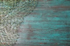 Fishing net on wooden background, top view. With space for text royalty free stock photo
