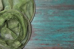Fishing net on wooden background, top view with space. For text royalty free stock image