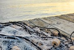Fishing net on wooden pier royalty free stock image