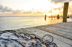 Fishing net on wooden pier royalty free stock photos
