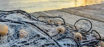 Fishing net on wooden pier stock images