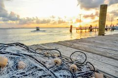 Fishing net on wooden pier stock image