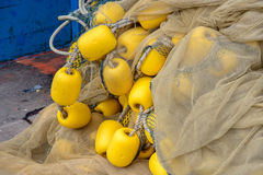 Fishing net and yellow buoys Stock Images
