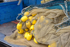 Fishing net and yellow buoys Royalty Free Stock Images