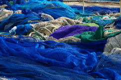 Fishing nets. Blue and green fishing nets stock photos