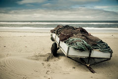 Fishing nets. Towing, with fishing nets washed up on the sandy beach of Mira in Portugal Royalty Free Stock Images